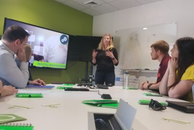 Amy Ankrum, president and CEO of Qualtrax, discusses the core values of her company, in a presentation to  a group that included the Executive MBA students and two Virginia Tech faculty members.